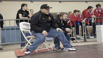 The coaches were literally on the edges of their seats throughout the state tournament as they watched their athletes compete on the mats.