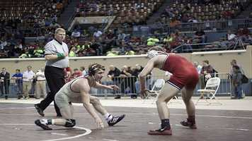 Salina's Cullen Patterson and Geary's Bradley Ray during their Class 3A consolation finals match at 120 lbs.