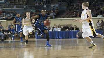 Eric Harris (13) sprints downcourt as he eyes the basket during the boys Class B state championship game.
