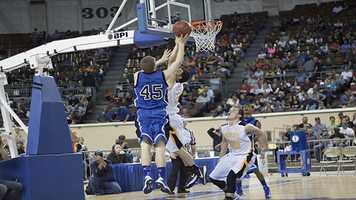 Heath Moorman (45) makes an attempt to score with an Arnett player making the attempt to block.