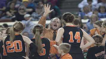 Cheyenne-Reydon's head coach Brad Thrash tries to inspire his team during a timeout.