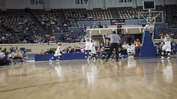Madi Grellner (15) takes a three-point jumper, which she connects during Okarche's 59-47 victory to win the Class A girls state championship.