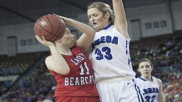 Erick's Maranda Janz (11) and Lomega's Hailey Duffy (33), become better acquainted after this play.