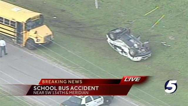 Collision with schools bus causes SUV rollover