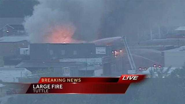 Crews are working a building fire in Tuttle. Highway 37 is closed.