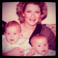 Maggie Stokes, her twin sister and their mother.