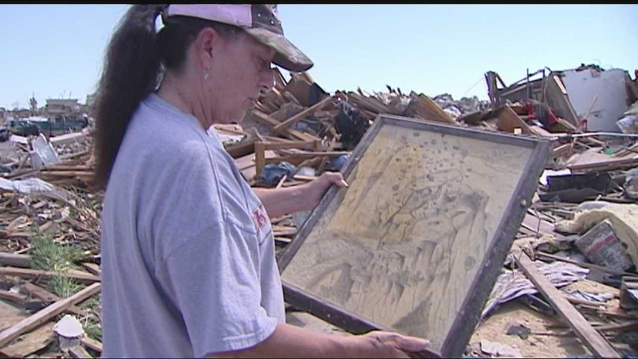 A special education teacher at who rode out the storm at Briarwood Elementary returns to what's left of her home in Moore.