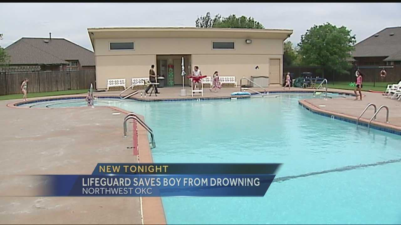 Jay Fanning pulls a 7-year-old boy out of a northwest Oklahoma City pool on Saturday. Fanning says he had to give the child CPR to save his life.