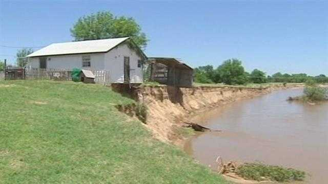 A family says the next rain storm could wash part of their home into the Canadian River.