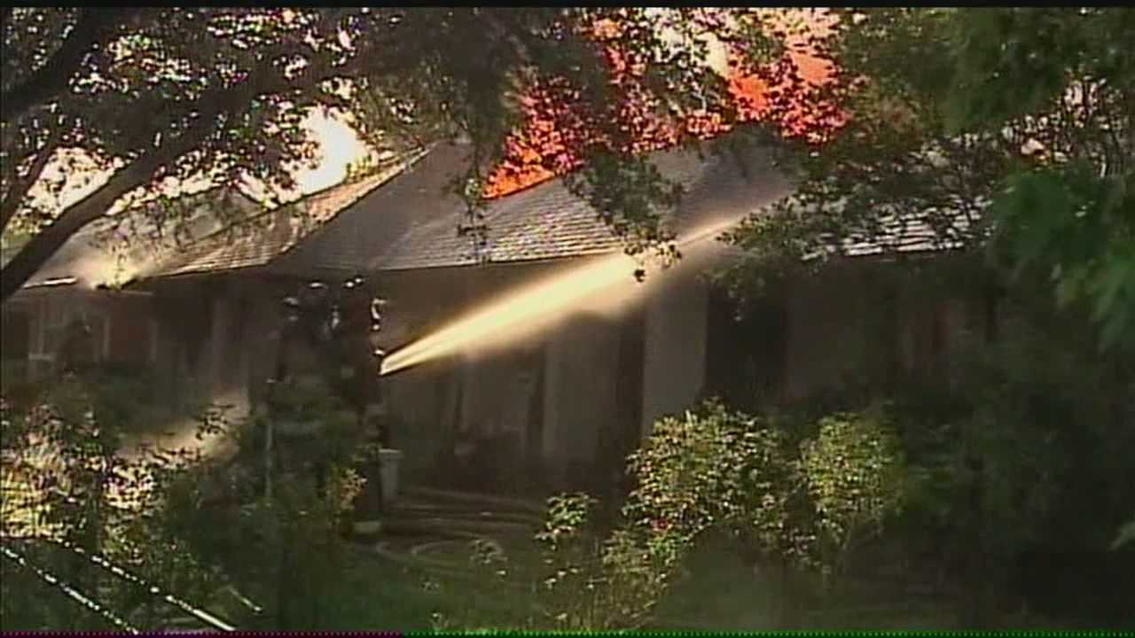 Two-alarm fire destroys family's home
