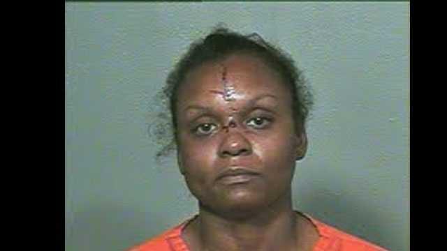Aisha Smith, 36, was arrested on suspicion of first-degree murder of her boyfriend, Walter Garland, 48.