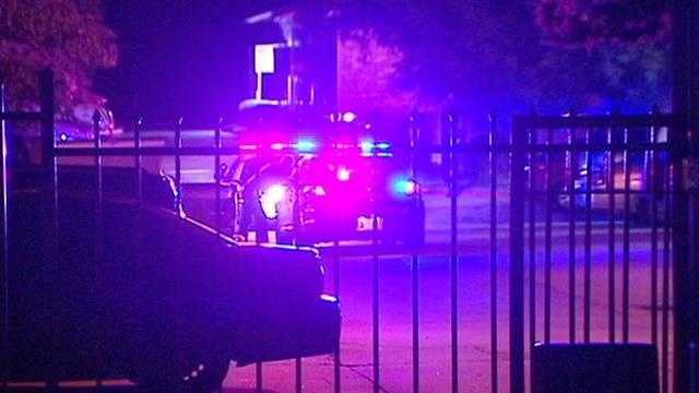 A woman was injured during a gunfight at an Oklahoma City apartment plagued with problems. The woman was not shot but police say she was hurt when two men started shooting at each other.