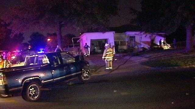 Chase suspect slams truck into home