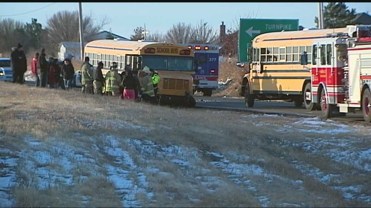 Two teenager girls were injured when the truck they were in collided with a Yukon school bus carrying 60 students.