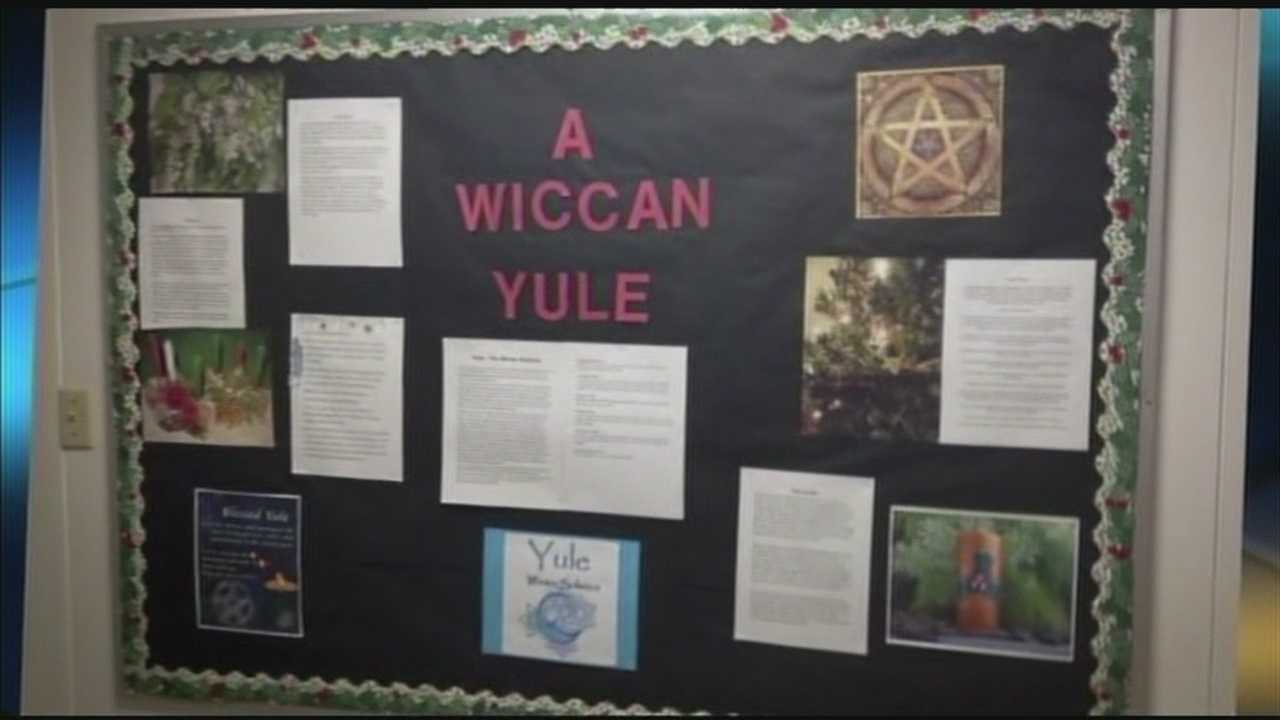 A Tecumseh school took down all religious displays after parents raised concerns over a Wiccan display.