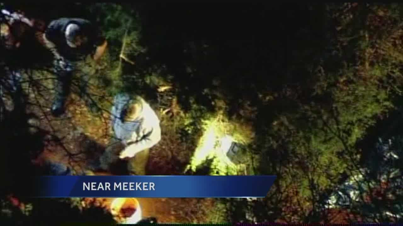 Multiple law enforcement agencies are investigating the discovery of a body Wednesday in a grave near Meeker.