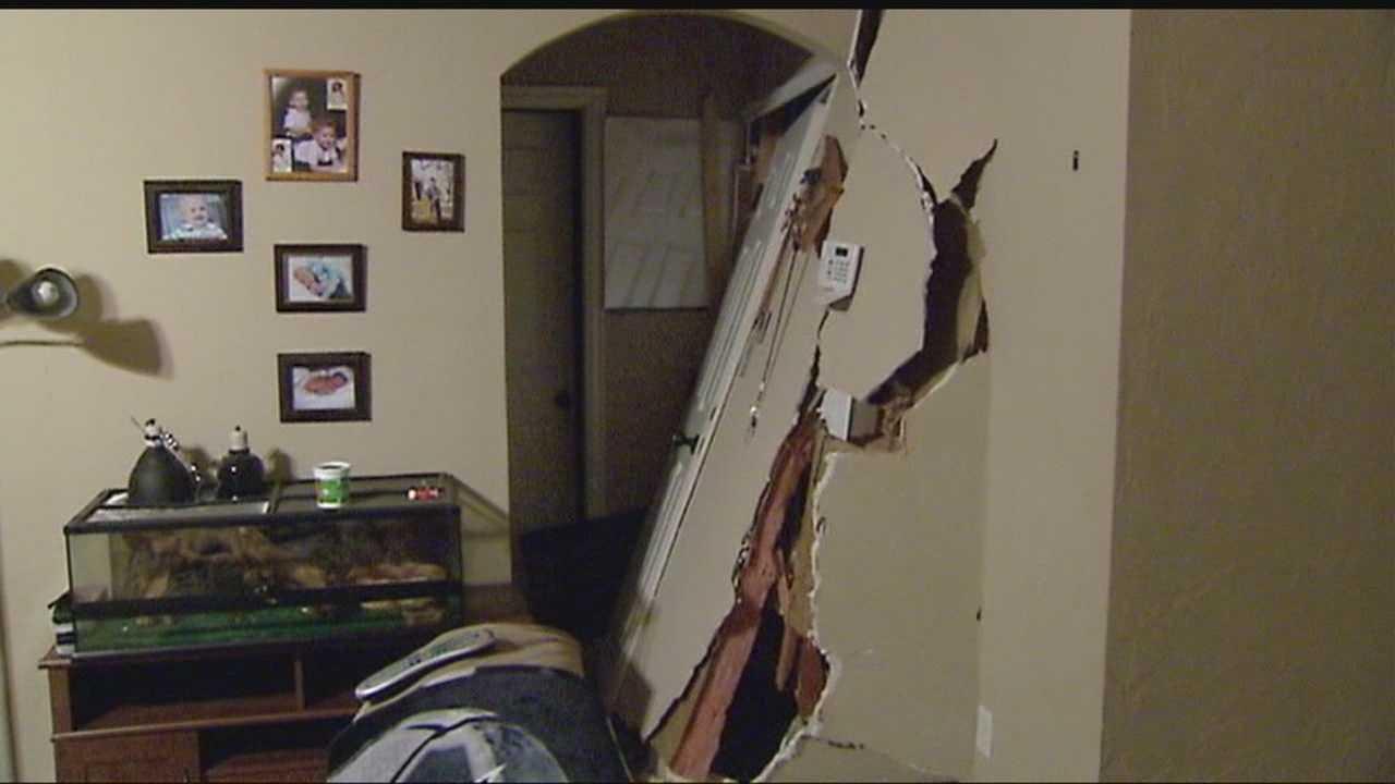 Man says Neighbor Slammed Pickup into Home