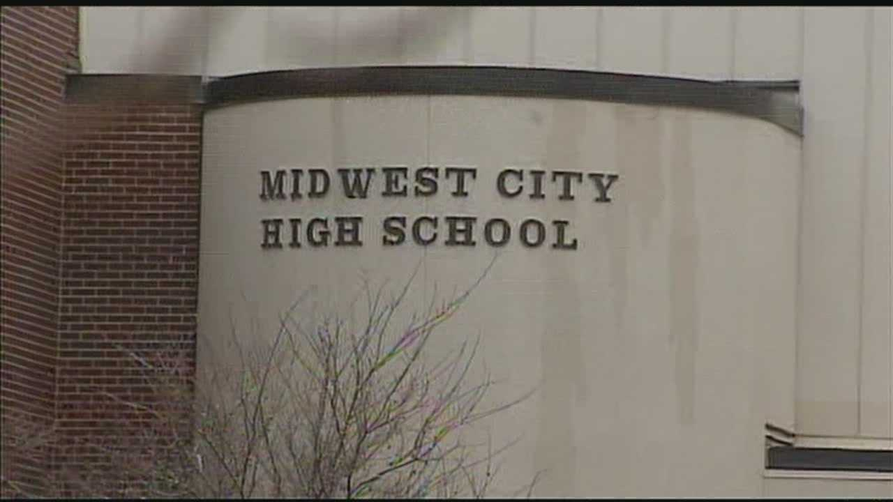 Administrators say two teens have been removed from Midwest City High School for the remained of the year after one of them lit another student's hair on fire, according to court documents.