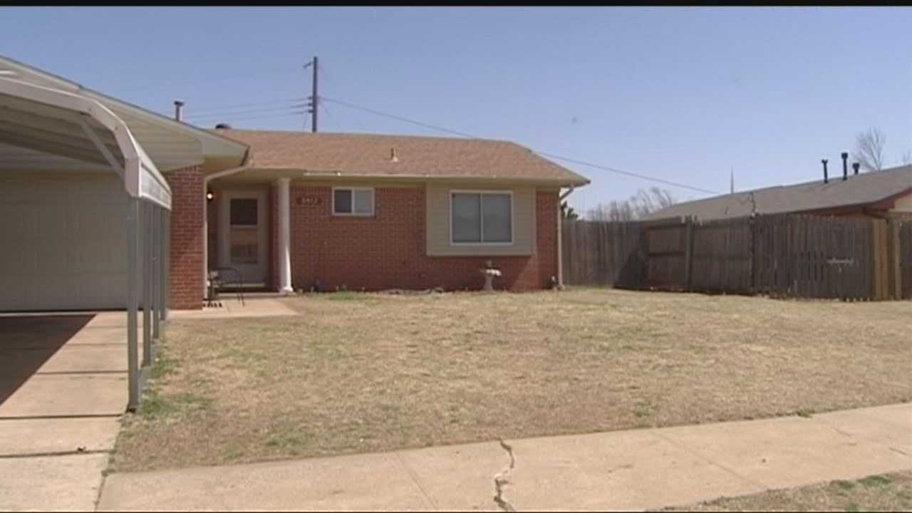 Children are removed during a drug house raid in Oklahoma City.