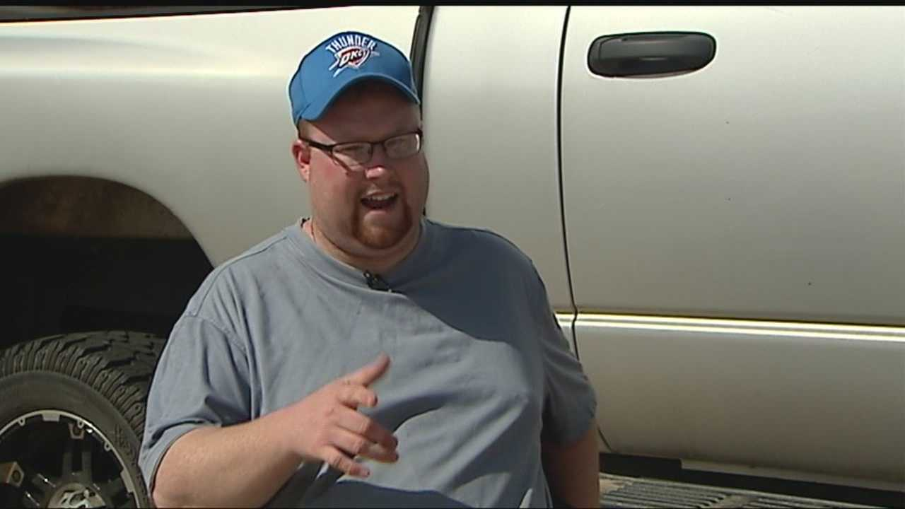 A Moore homeowner fired a shot at an armed man he said jumped the fence into his yard.
