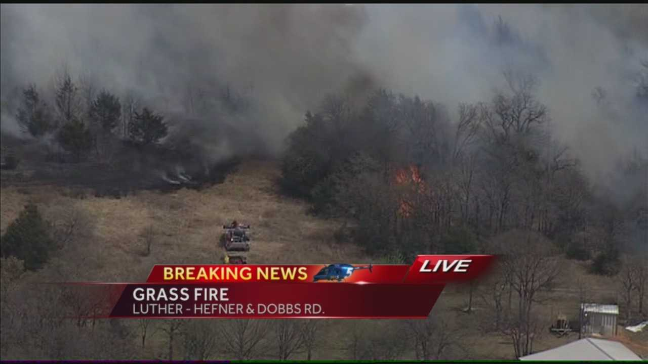 Grass fire burning in Luther