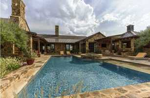 This home sits on 15 acres of land that overlooks a private lake.  As you can see, it's designed with outdoor entertaining in mind.  It has some amazing workmanship inside.  For more information on this property in Edmond, click here.
