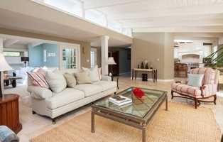 Their Malibu home at 28020 Sea Lane Drive is a comfortable retreat with white-painted beamed ceilings, an outdoor fireplace and a large master suite that was added during the remodel, according to Zillow.
