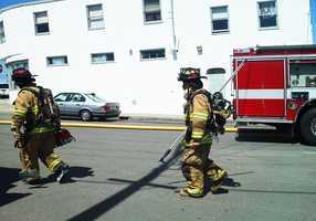 All of the building's residents ran out when the fire sparked at 1:30 p.m.  (April 4, 2012)