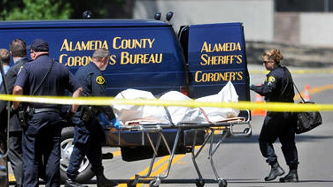 Alameda County Coroner's officials transport a body found in Pleasanton on Thursday.Photo by Doug Duran / Contra Costa Times