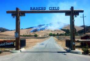 A wildfire blackened about 15 acres on a hill above Rancho Cielo on Old Stage Road in Salinas on Thursday.