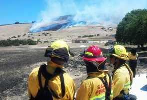 Flames ignited in dry brush at 12:30 p.m. Thursday. Firefighters quickly brought the blaze under control using helicopters.