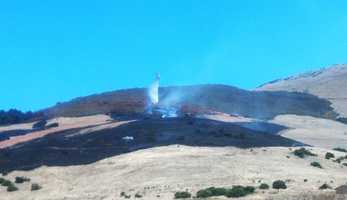 A wildfire blackened about 15 acres on a hill above Rancho Cielo in Salinas on Thursday.