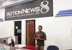 Photographer Joab Perez has a happy smile in the newsroom....