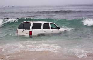 A witness said the white Escalade was traveling at a high rate of speed when it careened off 17 Mile Drive, plowed over a sandy beach, and zoomed into the ocean at 11:15 a.m. (Aug. 24, 2012)