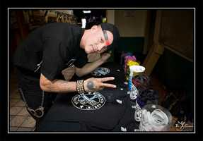 Chris Rene signs T-shirts to benefit Santa Cruz-based nonprofit Grind Out Hunger.
