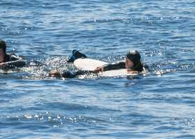 Professional surfer Craft ditched his own board because he knew he could swim faster toward the injured man without it.