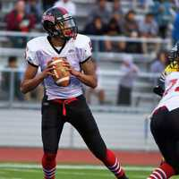 Seaside Varsity quarterback Michael Turner scans the field while playing against Jefferson in Daly City.