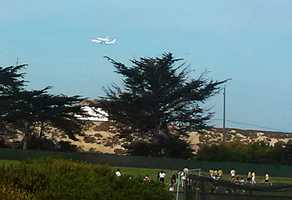 Soccer players in Seaside called a timeout for the shuttle's flyover.