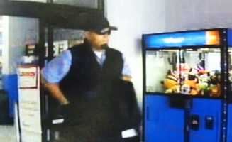Chacon was pulled over on the 1900 block of Constitution Boulevard because police believed he was the gunman who robbed a Walmart on North Main Street in Salinas.PPolice said Chacon is seen in this surveillance image dressed as a security guard while robbing the Walmart on Sept. 27.