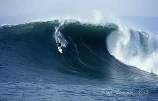 The real Jay Moriarity is seen ripping across a massive wave at Mavericks.
