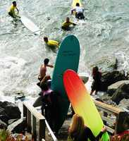 The film crew re-created the paddle out at Pleasure Point and used hundreds of local surfers as extras for the scene.