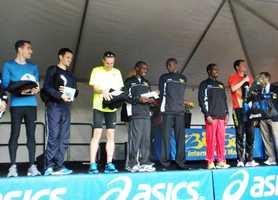Winners of the Big Sur International Half Marathon's men's division celebrate after the race.