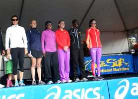 Winners of the Big Sur International Half Marathon's women's division celebrate after the race.