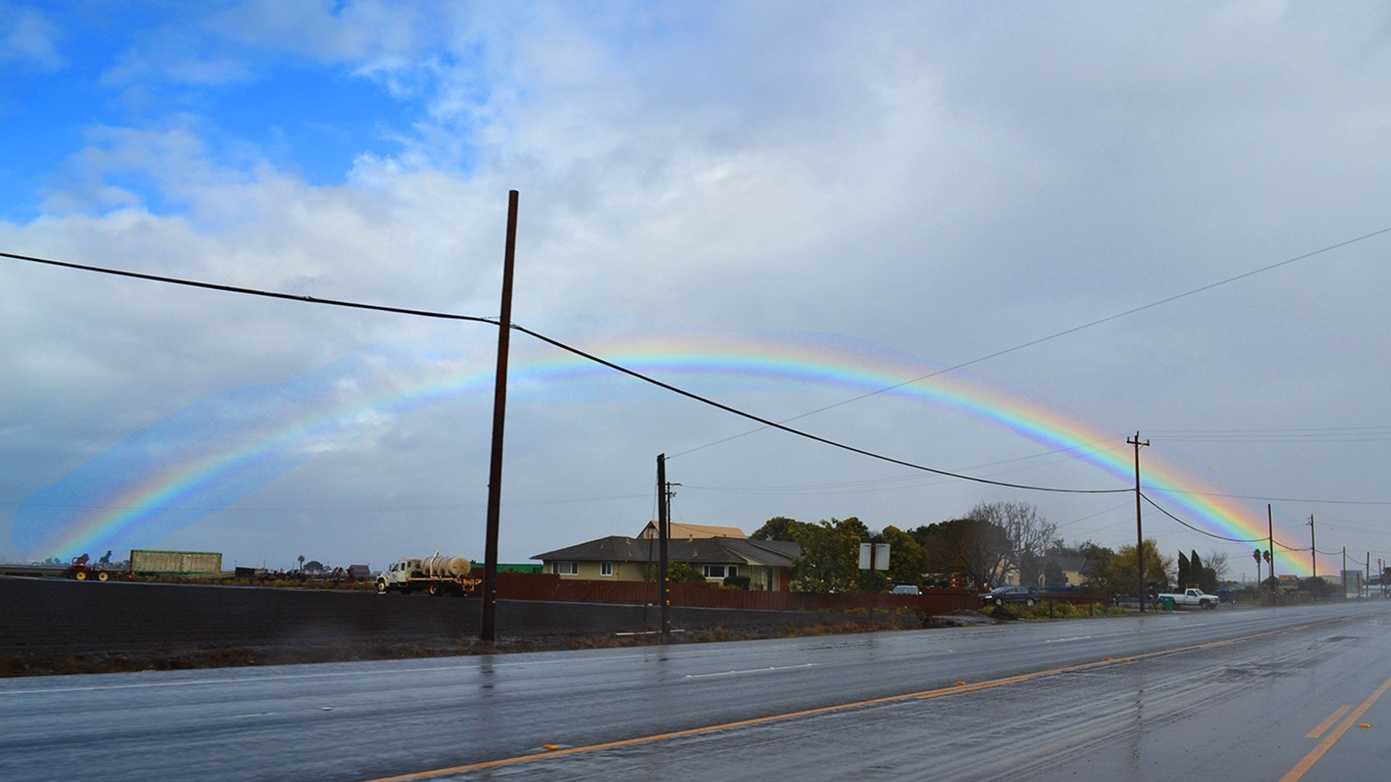 A brief moment of sunshine happened in Salinas, and as the sun pierced through the clouds, a giant rainbow formed near Highway 68 Wednesday morning.