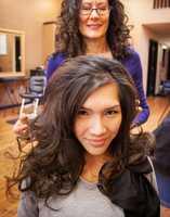 Gotta love big hair. Vo said she will wear her hair down in big loose curls.