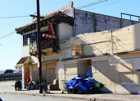 Salinas city public works crews and police officers did homeless camp sweeps along Soledad Street in Chinatown on Jan. 31, and again on July 25 this year.