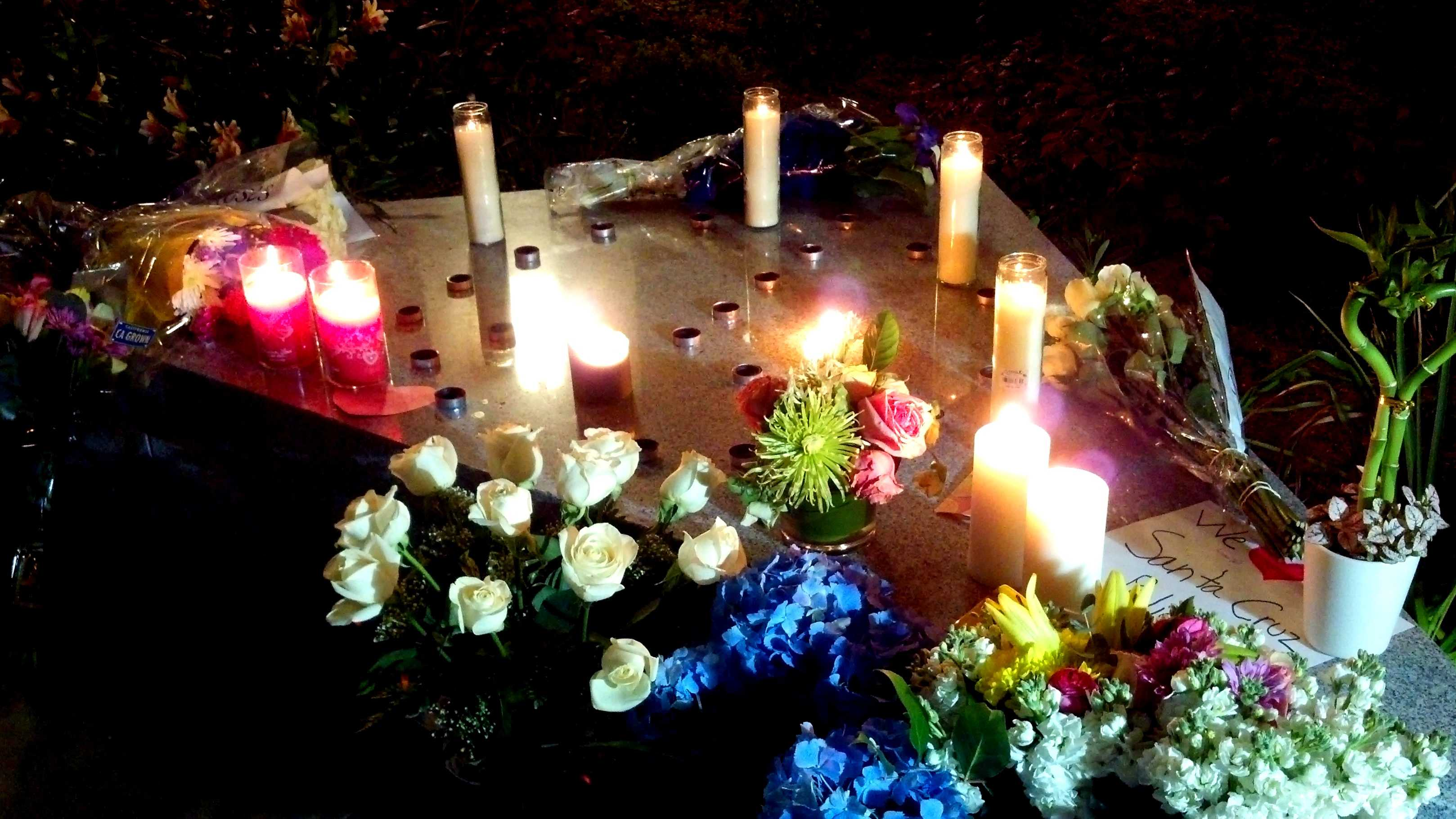 This memorial was built outside the Santa Cruz Police Station Tuesday night.
