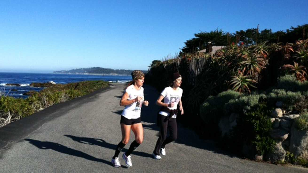 Jennifer Field, left, and Lori Haines, right, are seen running together Wednesday.