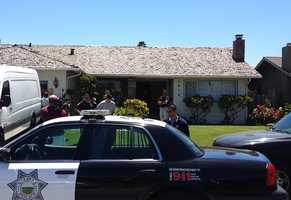 Curt Tamanaha is lead away from his parent's house on the 1000 block of Driftwood Place in handcuffs. (May 29, 2013)