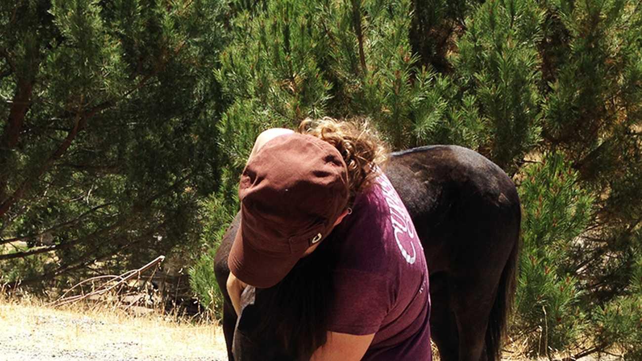 Candace Allen gives her little horse a big hug on Thursday. (June 13, 2013)